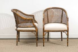handsome mellow pair of faux bamboo and cane barrel back armchairs while the chairs