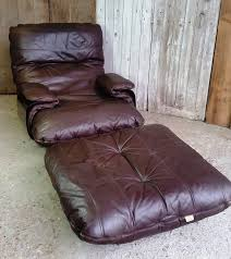 leather chair with footstool aldi quality recliner swivel single rocking ottoman corner sofas formidable armchair reclining