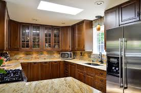 new venetian gold granite countertops with tile backsplash