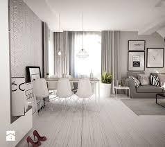 czarno białe mieszkanie z antresolą Średni salon z jadalnią z tarasem balkonem styl