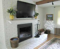 painted white brick fireplacePainted Brick Fireplace Makeover  Paint brick fireplaces Brick