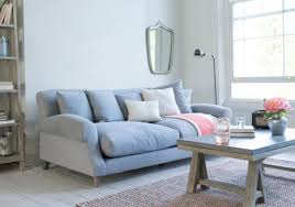 comfortable couches. This Dusty Crumpet Sofa With A Velvety Surface Is Paired White And Blue Throw Pillows Comfortable Couches