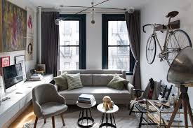 small living room furniture. Small Living Room With Couch, Bike Hanging On Wall, And Floating Desk Furniture