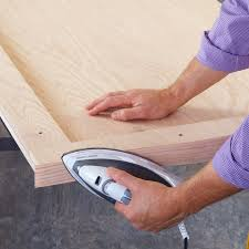 add the wide veneer edging to the panels with an iron