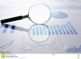 Accounting Data Charts And Magnifying Glass Stock Photo