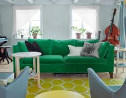 an emerald stockholm sofa a yellow rug and powder blue chairs add color to the