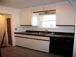 spray paint kitchen cabinets spray painting kitchen painting laminate kitchen cabinets before and after