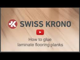 how to glue a laminate flooring plank