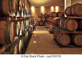 Wine barrels Stacked oak wine barrels in winery cellar