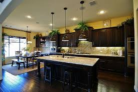 dark wood kitchen cabinets. Kitchen:Delightful Dark Kitchen Design With Yellow Wall Color And Wood Cabinet Ideas Cabinets H