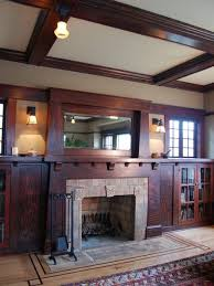 inspiration for a mid sized craftsman enclosed light wood floor living room library remodel in