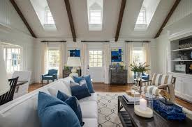 Great room with vaulted ceiling uses open dormer windows to provide extra  light.