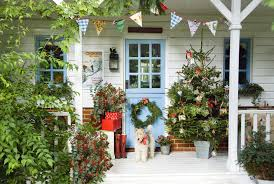 Cozy rustic outdoor christmas decoration ideas Rustic Farmhouse 40 Outdoor Christmas Decorations Ideas For Outside Christmas Porch Decor Country Living Magazine 40 Outdoor Christmas Decorations Ideas For Outside Christmas Porch