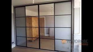 White Door Black Trim Built In Sliding Door Wardrobe Pure White Glass Black Frame