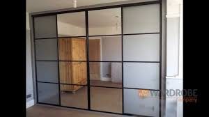 built in sliding door wardrobe pure white glass black frame silver trim you