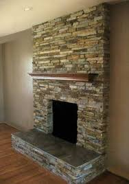 Stacked Stone fireplace/add power and cable above the mantel w/TV bracket
