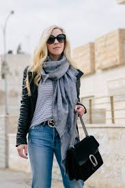 meagan brandon fashion blogger of meagan s moda wears black leather jacket with striped tee gray louis vuitton scarf and gucci belt outfit idea with louis