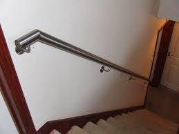 stainless steel handrails for stairs on white wall