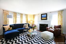 black and white chevron rug with transitional living room and electric blue zig zag jewel tone window treatments fireplace