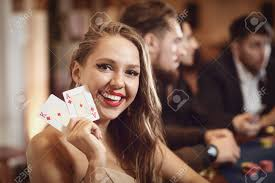 Girl With Cards In Her Hands Smiles Rejoices At Winning Poker.. Stock  Photo, Picture And Royalty Free Image. Image 135875054.
