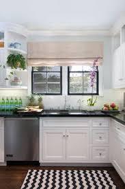 Charming Interior Design By Anna Hackathorn. Kitchen, Black Counters, Black And White  Zig Zag Rug, Black Windows.