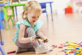 Cute toddler girl playing with toys on floor The 11 Best Toys to Buy for 3-Year-Old Girls in 2019