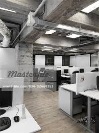 Industrial modern office Flooring Modern Industrial Office With Rows Of Computers Stock Photo Masterfile Modern Industrial Office With Rows Of Computers Stock Photo