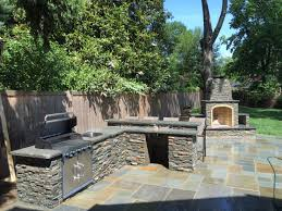 flagstone patio outdoor stone kitchen bar grill fireplace