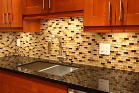 a gl tile backsplash with accents of gold and red