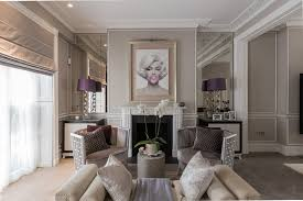 Transitional formal living room photo in London with gray walls and a  standard fireplace