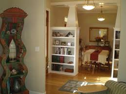 Amazing White Wooden Cabinetry Shelf Living Room Divider As Divide Living  Areas And Dining Areas Also Ceiling Lights Fixtures Pictures