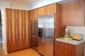 mid century modern kitchen with walnut cabinets