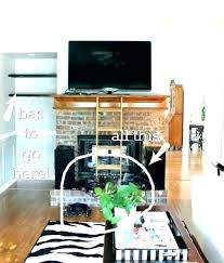 how to mount tv over fireplace and hide wires wall