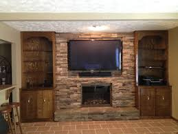 tv mounted new stone face and rock fp door and stone facing fireplace services omaha fireplace services new and repair