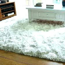 large white gy rug rug under bed