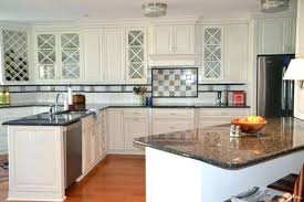 white kitchen cabinets with black wood antique dark granite countertops