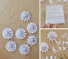 paper snowflakes 3d 3d paper snowflakes made into a garland artbar