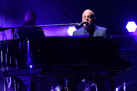 photos of the ian billy joel performing live on stage at madison square garden in new