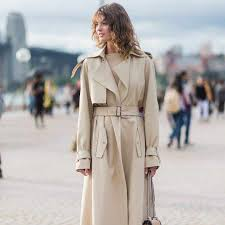 trench coats have remained fashionable in the decades following world war ii their original role as part of an army officer s uniform lent the trench coat