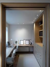 built in home office. inspiration for a contemporary dark wood floor home office remodel in london with white walls built n