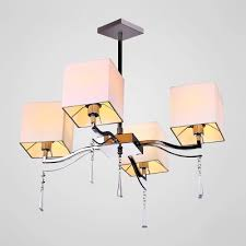rectangular beige fabric shades and faceted crystal drops add glamour to stunning pendant light