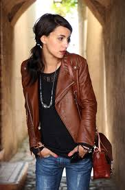 brown leather topper is a great addition try it on atop black knitted sweater teamed with slim jeans