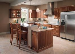 kraftmaid kitchen cabinets ideas using brown wood kraftmaid wall mounted kitchen cabinets with silver chimney hood and double doors cabinets with silver top