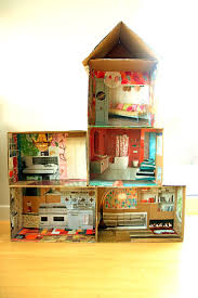 cardboard doll house with magazine pictures.