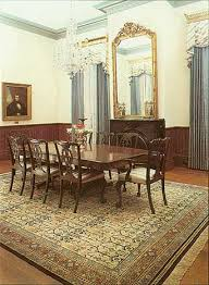 the traditional decor and furniture in this dining room are complemented by this oriental rug handknotted in china