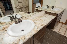 colonial gold granite countertop and bacal floor tile master bathroom vanity