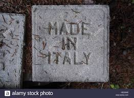 Made in Italy cast onto the back of a floor tile Stock Photo - Alamy