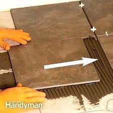 how to install tile flooring over concrete how to install tile on concrete floor photo 3 set the tile install ceramic tile over putting vinyl tile on