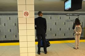 photo essay commute krysten mccumber a businessman stands and waits for the subway at islington station photo by krysten