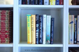 how to stack books in a bookcase the